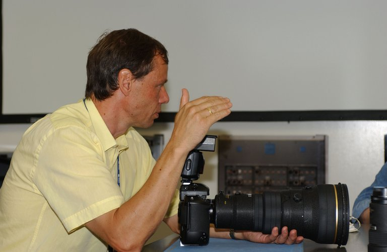 Christer Fuglesang practices with a camera during training