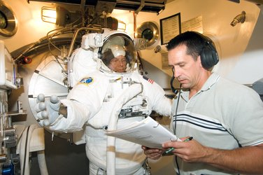 Fuglesang participates in EVA spacesuit fit check