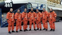 Members of STS-116 and Expedition 8 crew