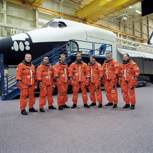 Members of STS-116 and Expedition 8 at NASA's Johnson Space Center