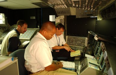 Robert Curbeam and Christer Fuglesang during training in Space Shuttle simulator