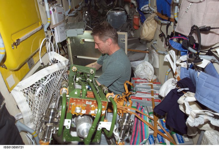 Thomas Reiter carries out a maintenance task in the Zarya module