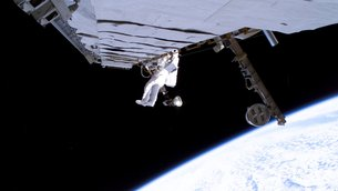 Thomas Reiter works on a cooling line in the S1 truss of the