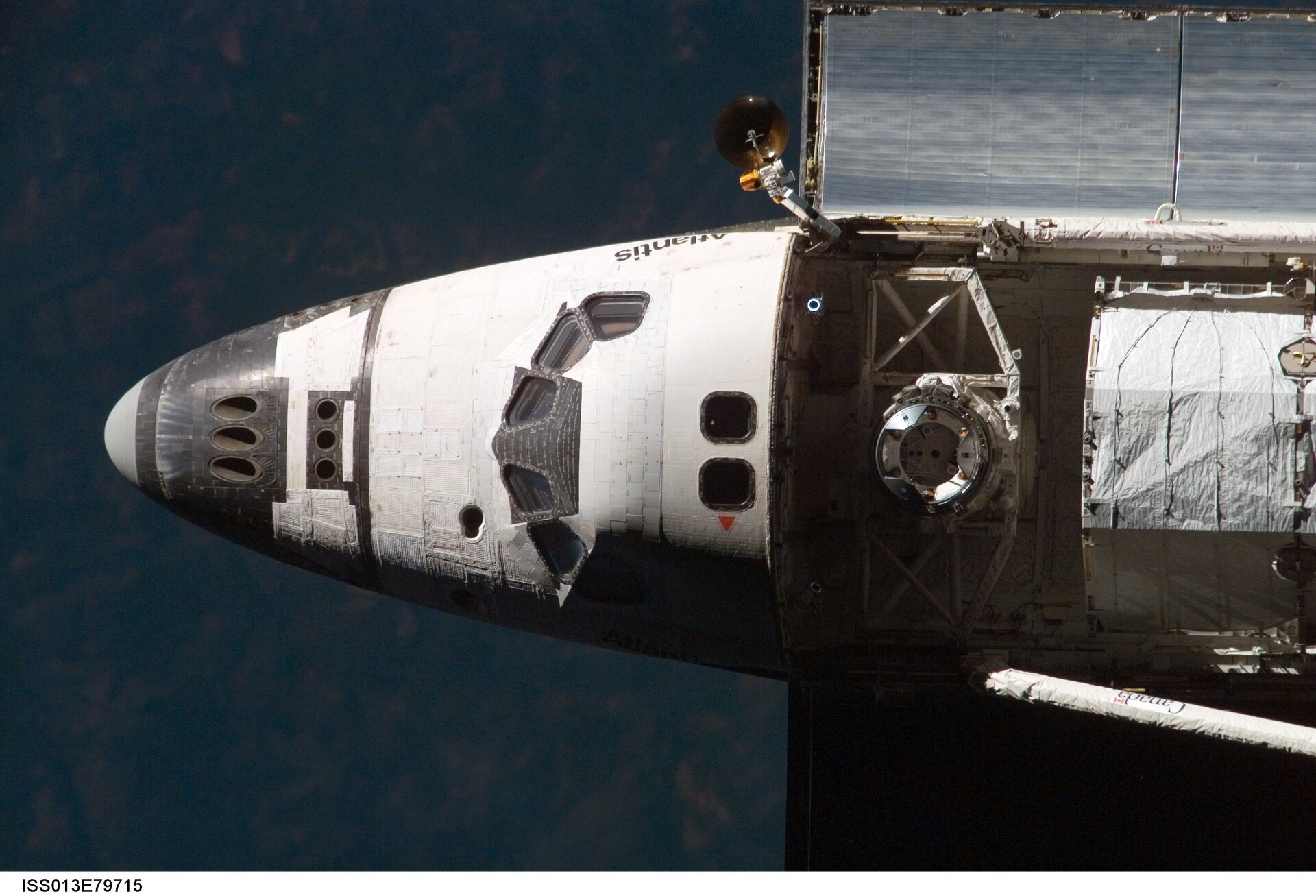 Image of the Space Shuttle approaching the orbital outpost
