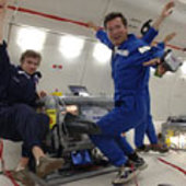 Two team members and their experiment in Zero-G