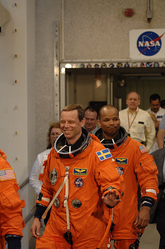 ESA astronaut Christer Fuglesang and the rest of the STS-116 crew on their way to the launch pad for the practice countdown