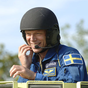 ESA astronaut Christer Fuglesang practices driving an emergency evacuation vehicle