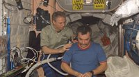 Reiter cuts Tyurin's hair on ISS