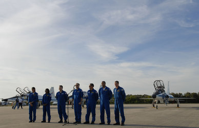 The STS-116 crew arrives for terminal countdown demonstration test (TCDT) activities at NASA's Kennedy Space Center