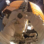 Reflected scene during fourth spacewalk of STS-116