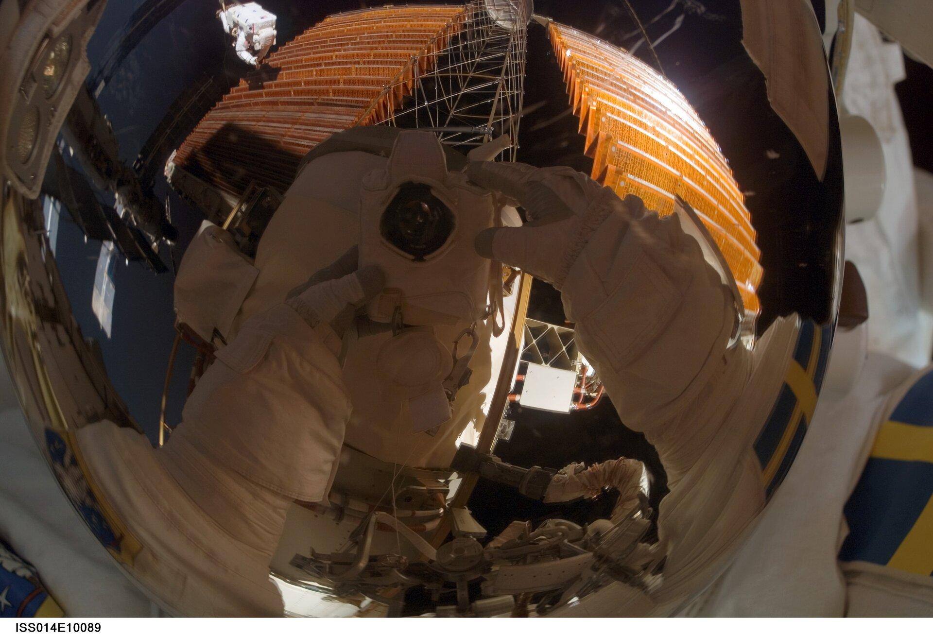 A reflection in Christer Fuglesang's helmet during the fourth STS-116 spacewalk