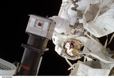 Astronaut Christer Fuglesang replaces a faulty TV camera on the exterior of the International Space Station