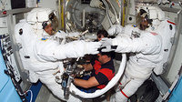 Fuglesang and Curbeam prepare for spacewalk
