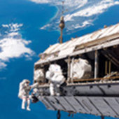 Fuglesang and Curbeam during first EVA