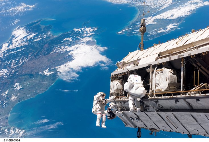 Fuglesang and Curbeam during the first spacewalk