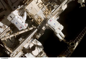 Fuglesang and Curbeam during the spacewalk