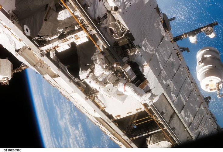 NASA astronaut Robert Curbeam during the first spacewalk of the STS-116 mission
