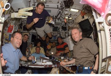 Shuttle and Station crews dining together in the Zvezda Module