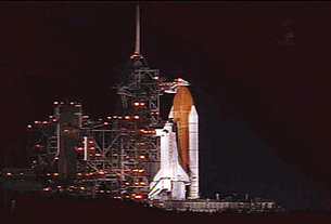 Space Shuttle Discovery awaits launch on Pad 39B