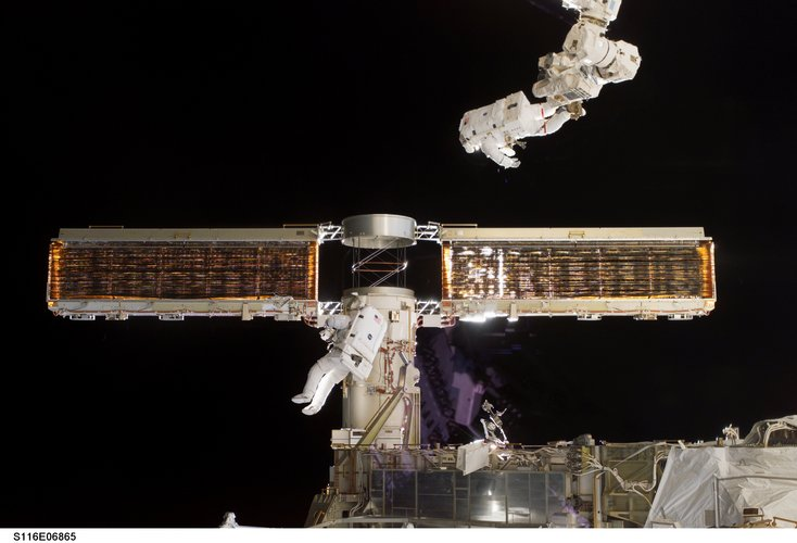 The P6 solar array is successfully retracted following an extra spacewalk