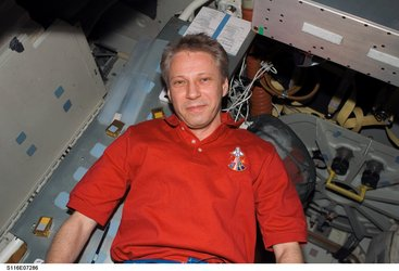 Thomas Reiter inside Space Shuttle Discovery