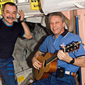 Reiter plays guitar on ISS