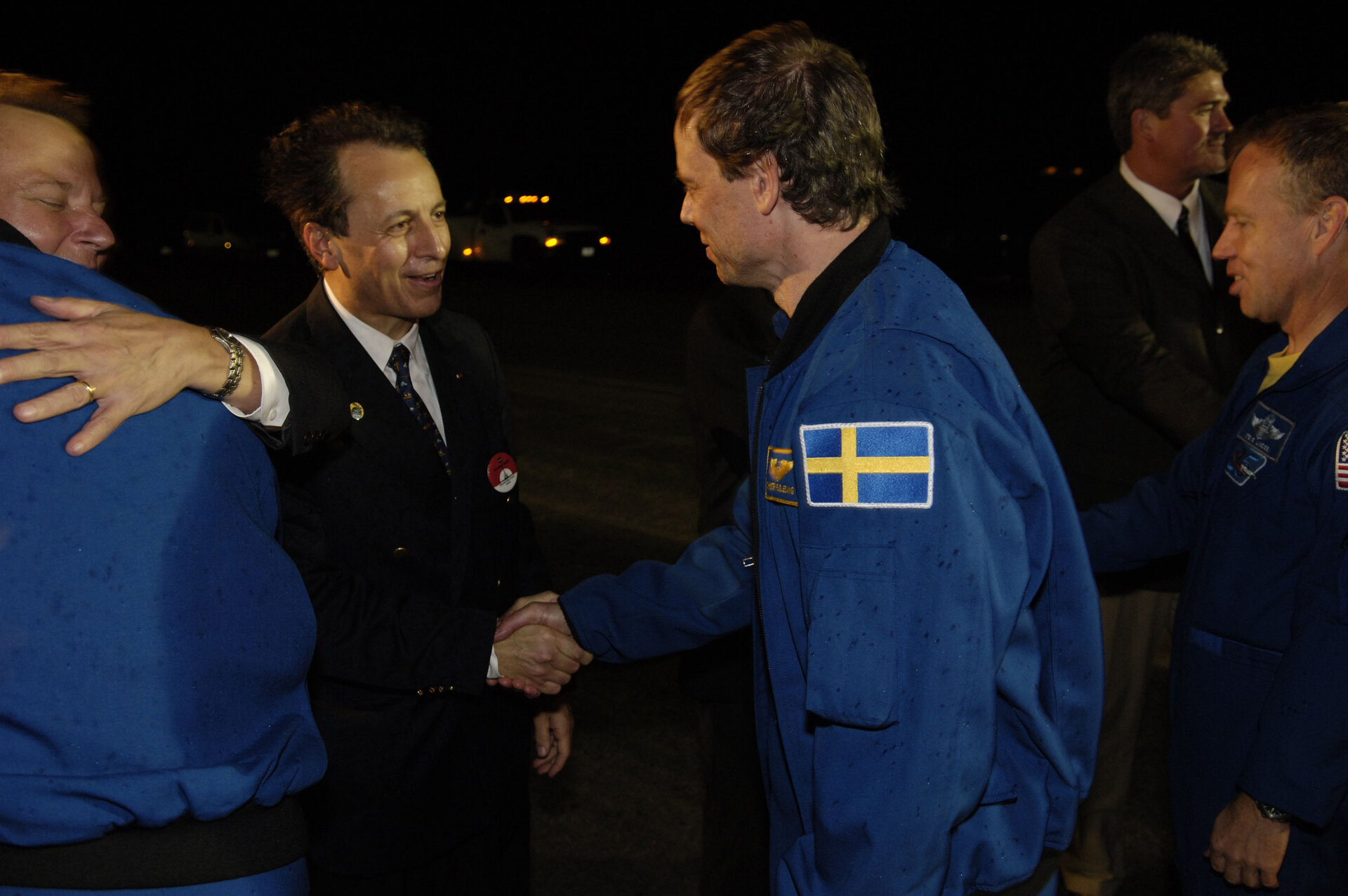 Shortly after landing Fuglesang is welcomed back by Michel Tognini, Head of the European Astronaut Centre
