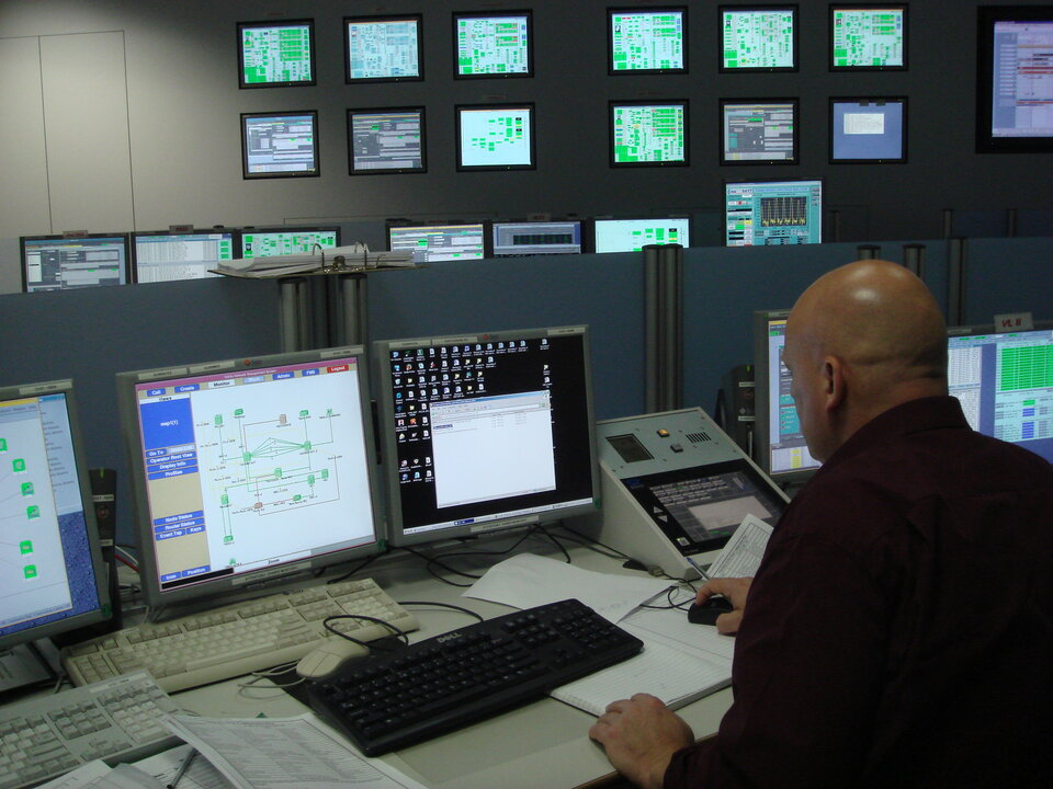 Engineers at work in ESOC's ESTRACK Control Centre