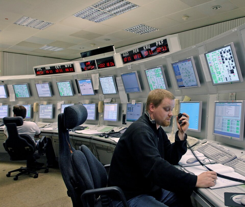 Station controller at work in ESOC's ESTRACK Control Centre