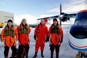 Scientists next to the Polar 2 aircraft from AWI