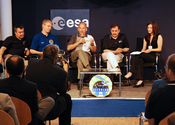 ISS Expedition 13 and 14 during a press conference at EAC