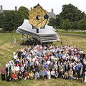 JWST team in front of real-size scale model