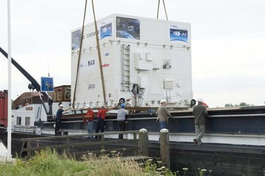 After arriving at Katwijk harbour, the spacecraft sections are loaded onto two canal barges