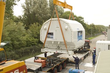 ATV transportation containers are loaded onto trucks outside the ESTEC Test Centre