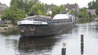 Canal barge passes through Leiden