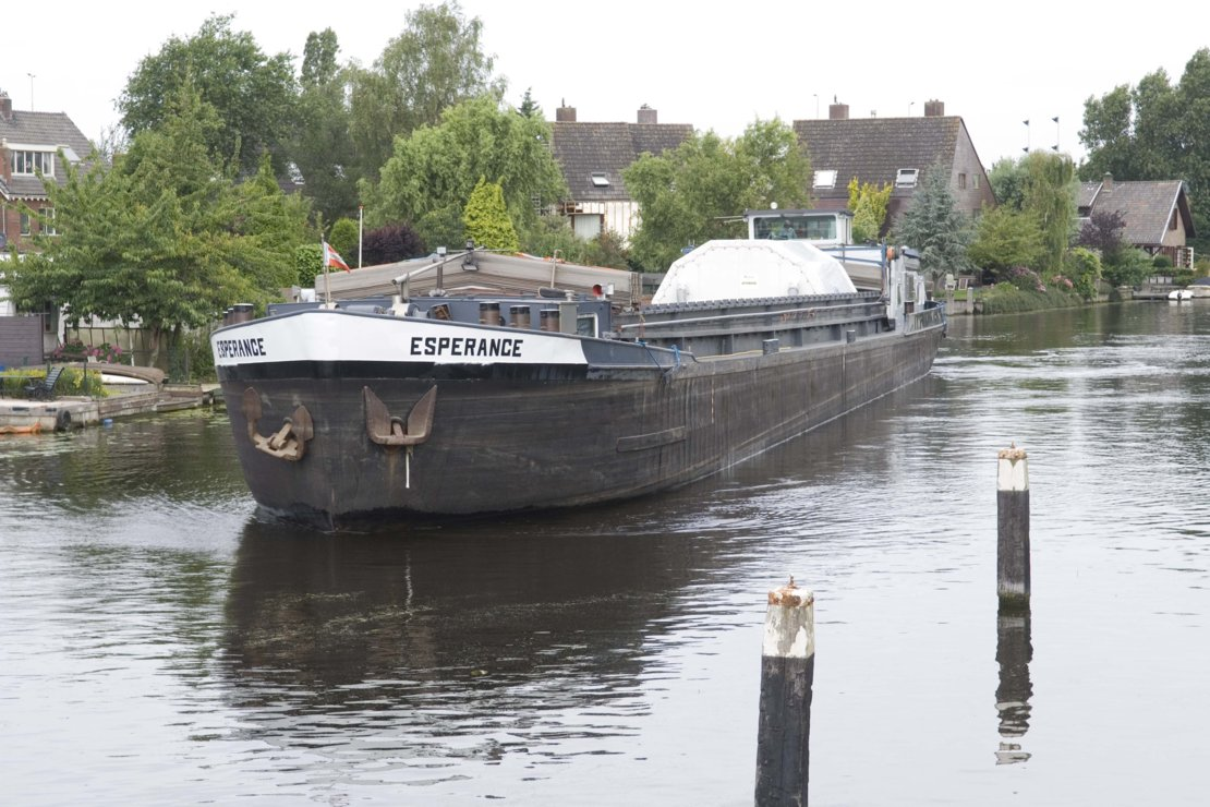 Canal barge carrying ATV's Integrated Cargo Carrier passes