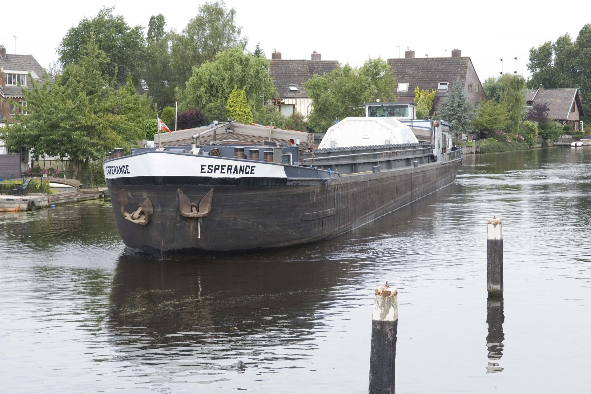 Canal barge carrying ATV's Integrated Cargo Carrier passes through Leiden