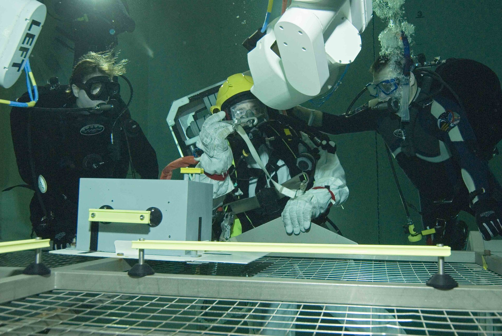 Eurobot could play an important role in EVA support - here Eurobot hands a tool to the astronaut