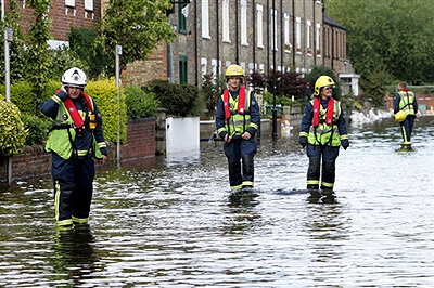 Rescue workers evacuate residents in Oxford