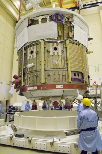 Section of ATV spacecraft is lowered onto transportation trolley