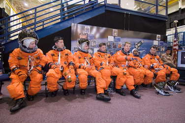 The STS-120 crewmembers await the start of a training session in the Space Vehicle Mockup Facility at Johnson Space Center