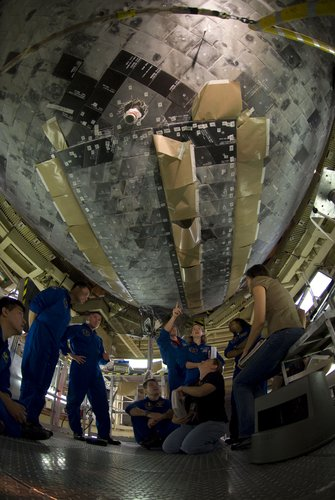 Crew of STS-120 with Paolo Nespoli inspect Discovery's heatshield during the CEIT at KSC