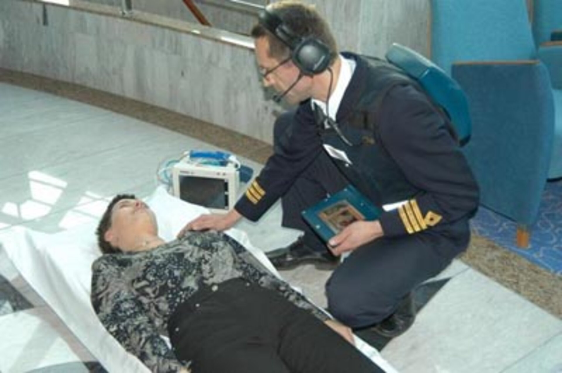 Medical assistant takes instruction from remote doctor