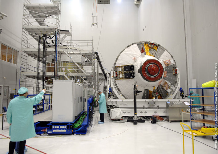 Technicians work on ATV in the S5 building at Europe's Spaceport in Kourou, French Guiana