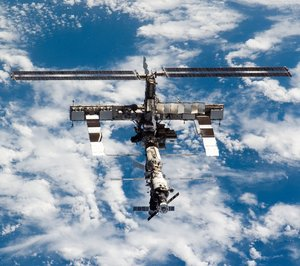 The P6 solar arrays (top of ISS) are shown fully extended