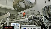 An overhead crane lifts the U.S. Node 2 module, known as Harmony