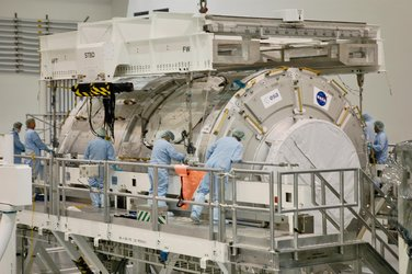 Technicians attach an overhead crane to the U.S. Node 2 module