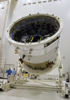 A section of Jules Verne ATV is rotated in order to attach the solar arrays to the spacecraft