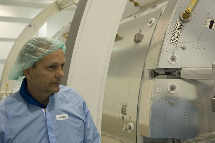 ESA astronaut Hans Schlegel inspects the European Columbus laboratory at NASA's Space Station Processing Facility