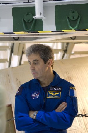 ESA astronaut Leopold Eyharts during an inspection of Space Shuttle Atlantis